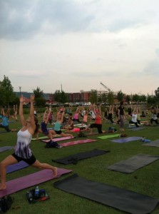 Yogis at Sunset Namaste in Railroad Park