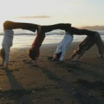 Yogis in partner poses