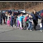 Children leaving Sandy Hook after the shooting